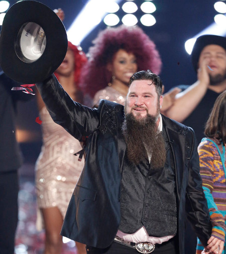 Sundance Head tips his hat to the crowd after  being named the Season 11 winner of The Voice. It marked Blake Shelton's fifth win as coach. (NBC Photo)