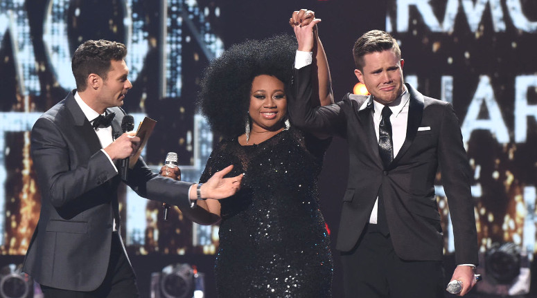 His arm raised by La'Porsha Renae, Trent Harmon breaks into tears when Ryan Seacrest announces him as the Season 15 winner of American Idol. (FOX Photo)