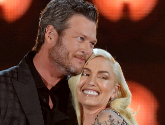 Blake Shelton and Gwen Stefani will be back as competing coaches on Season 12 of The Voice. (Billboard Music Award Photo)
