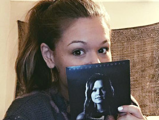 Caroline Glaser, former contestant from The Voice, with a copy of her new album.