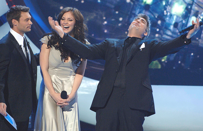 Taylor Hicks celebrates his victory on Season 5 of American idol while Ryan Seacrest and runner-up Katharine McPhee look on. (FOX Photo)