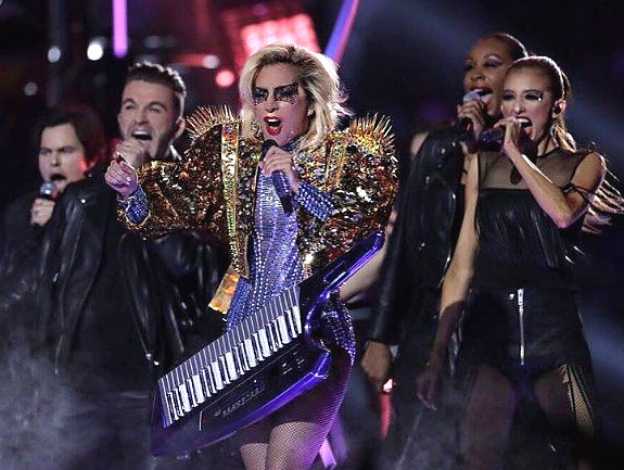 Luke Edgemon, second from left, performs with Lady Gaga during Sunday's Super Bowl halftime show.