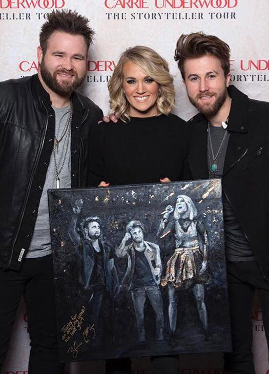 Zach and Colton Swon with Carrie Underwood during her Storyteller Tour.