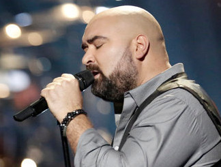 Troy Ramey performs in the battle round on The Voice. (NBC Photo)