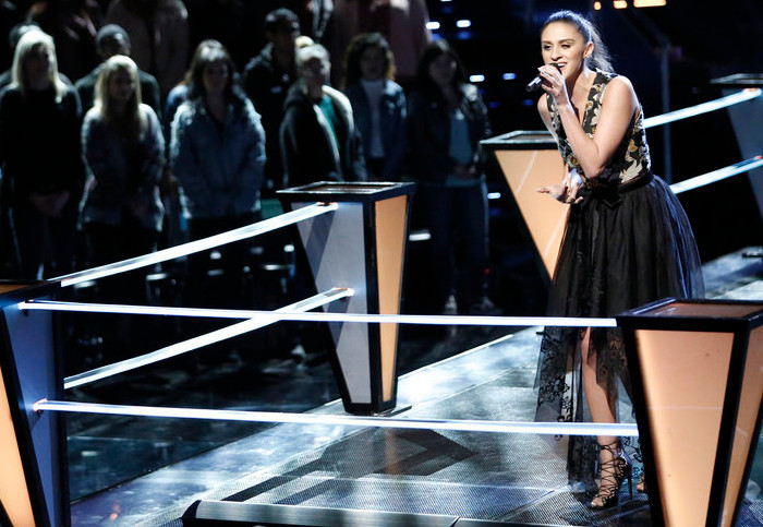Micah Tryba performs during the battle round on The Voice. (NBC Photo)