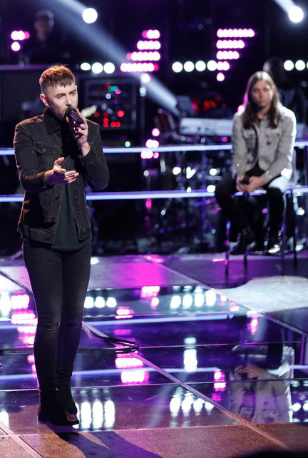 Hunter Plake performs during the knockout round on The Voice while Johnny Gates looks on. (NBC Photo)