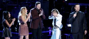 Stephanie Rice reacts to getting Alicia Key's save on The Voice while Anatalia Villaranda, Ashley Levin and Jack Cassidy congratulate her. (NBC Photo)