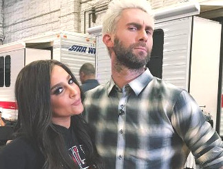 Alisan Porter and Adam Levine goofing around on the set of The Voice.