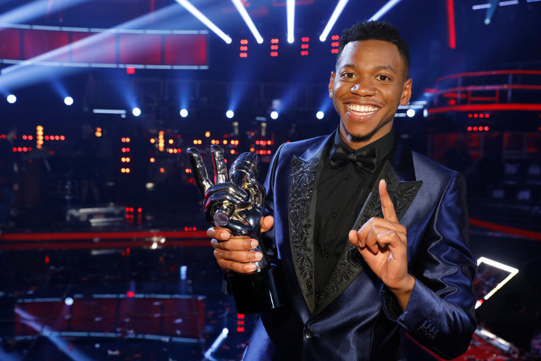 Chris Blue poses with the trophy for winning Season 12 of The Voice. (NBC Photo)