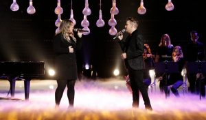 Kelly Clarkson and Billy Gilman perform during the Season 11 finale on The Voice
