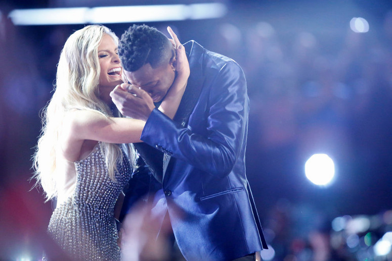 Chris Blue reacts to winning The Voice and is congratulated by Lauren Duski (NBC Photo)
