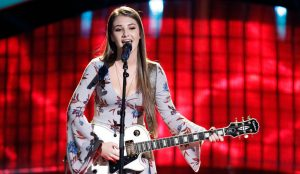 Alexandra Joyce performs during a blind audition that turned three chairs on The Voice Season 13. (NBC Photo)