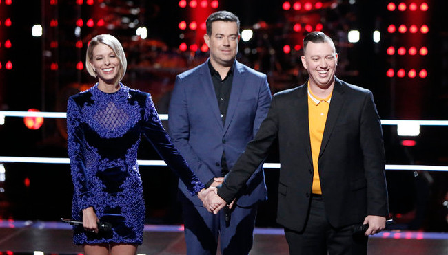 Emily Luther and Gary Carpentier await the outcome of their battle round match on The Voice. (NBC Photo)