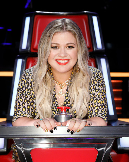 Kelly Clarkson, who will begin a guest mentor role on The Voice Monday, dropped her new album Friday.