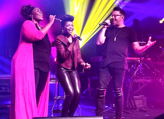 Mandisa, Jasmine Murray and Danny Gokey sing together on the Out of the Dark tour.