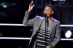 Eric Lyn performs during the battle round on The Voice. (NBC Photo)