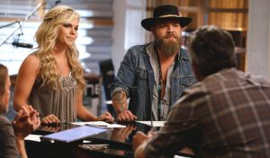 Natalie Stovall and Adam Cunningham review battle round strategy with Blake Shelton. (NBC Photo)