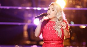 Sophia Bollman performs during the battle round on The Voice.