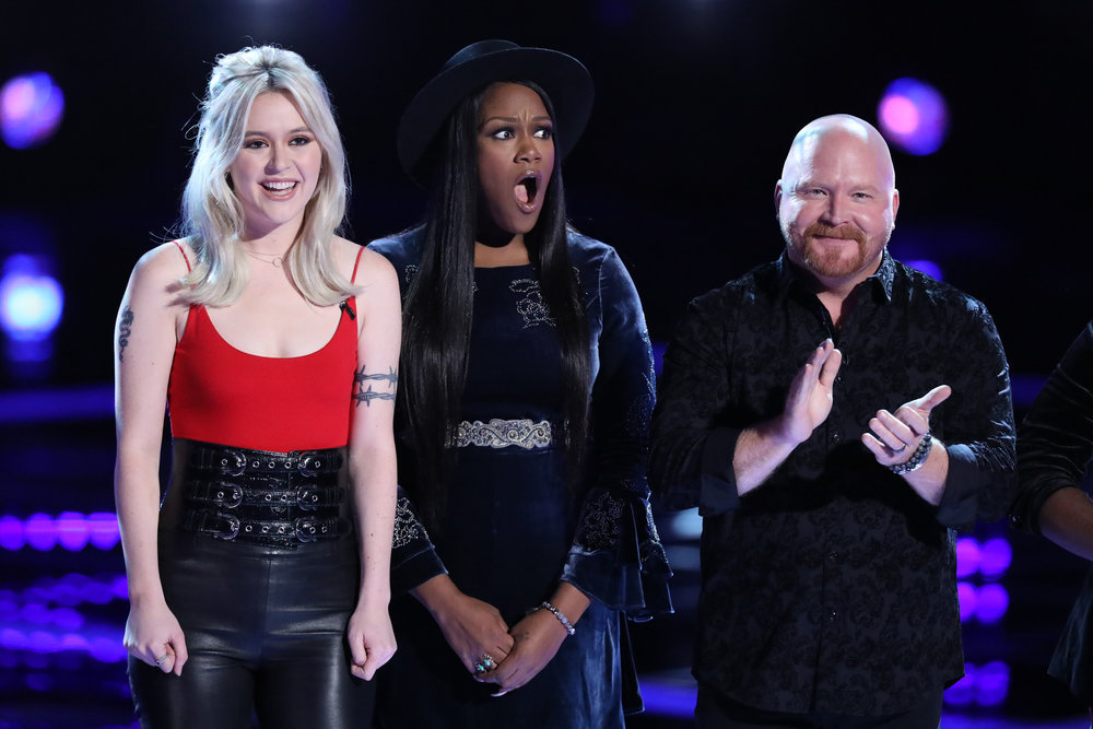 Keisha Renee shows her surprise at being the first singer sent to safety from Team Blake. She's flanked by Chloe Kohanski and Red Marlow (NBC Photo)