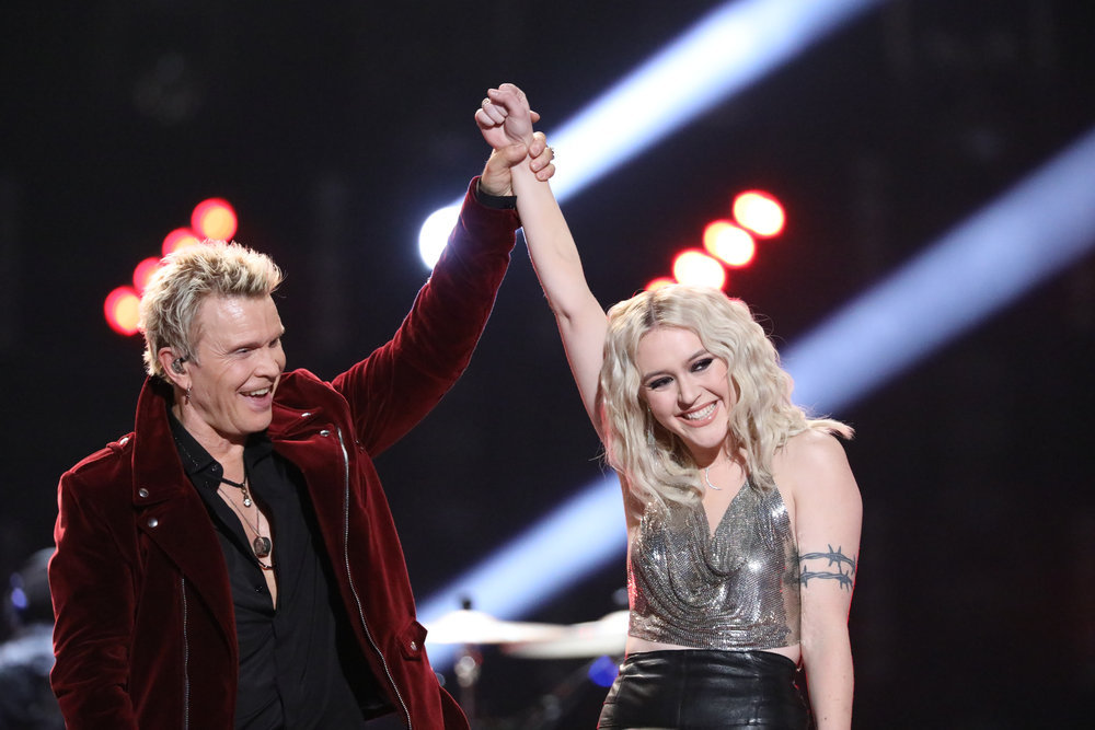 """Billy Idol raises Chloe Kohanski's hand in victory after their performance of """"White Wedding."""" It would prove a prophetic gesture. (NBC Photo)"""