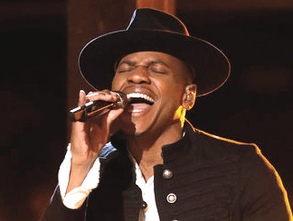 Chris Blue, Season 12 champ, performs on The Voice Tuesday night.