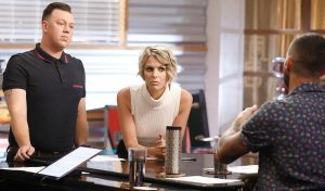 Gary Carpentier and Emily Luther prepare for their battle round match on The Voice with Adam Levine. (NBC Photo)