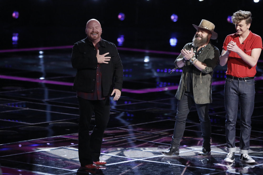 Red Marlow reacts to being named the fourth finalist on The Voice as Adam Cunningham and Noah Mac look on. (NBC Photo)